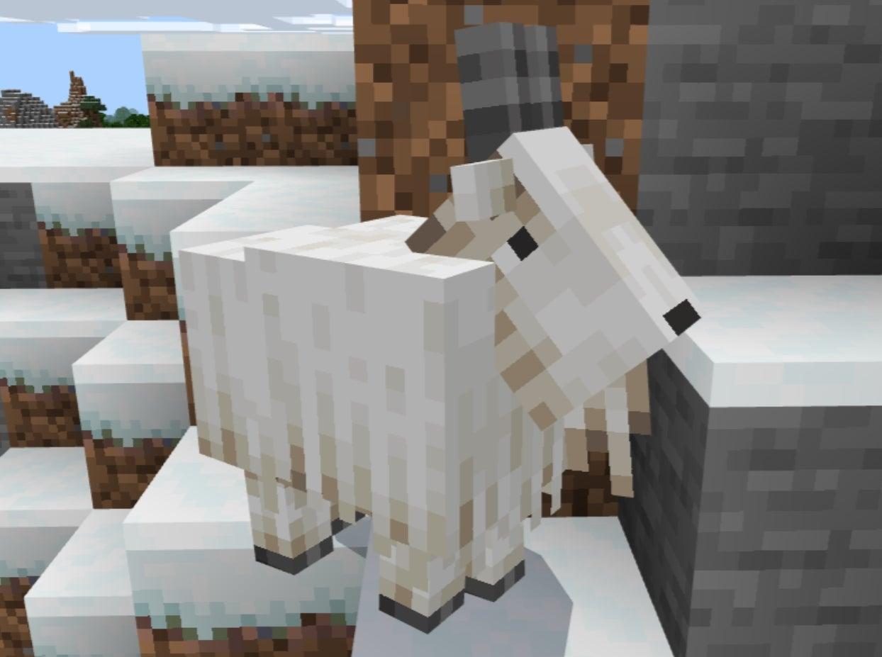 Bode numa montanha no Minecraft